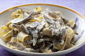 Fresh Tagliatelle with cream and artichokes — Stock Photo