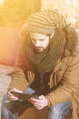 Reading outside a tablet instagram filter applied — Stock Photo