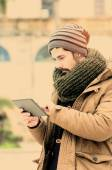 Bearded man using tablet in Mediterranean Country in instagram t — Stock Photo