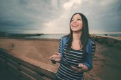 Woman with tablet smiling in winter warm filter applied — Stock Photo