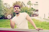 Athletic guy laughing warm tones filter applied — Stock Photo