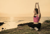 Woman doing fitness exercises warm filter applied — Stock Photo