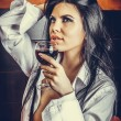 Sensual brunette young woman in  mans shirt  holding a glass of — Stock Photo #68593777