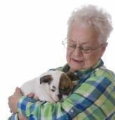 Senior woman and puppy — Stock Photo