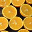 Oranges over black — Stock Photo #74694839
