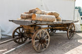 Russian cart with firewood — Stock Photo