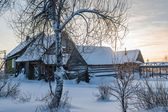 Cottage in the village one snowy morning in Russia — Stock Photo