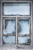 Misted snow-covered window country house — Stock Photo