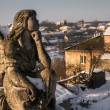 Stone figure of an angel on a background of the city — Stock Photo #63652363