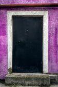 Locked door on the purple wall — Stock Photo