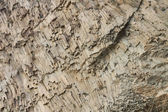 Ribbed texture of volcanic rocks on the cliff of Cape Fiolent — Stock Photo
