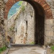 Entrance arch to the castle of Trencin in Slovakia — Stock Photo #64236457