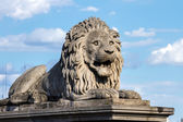 Lion on a pedestal on the support of the bridge in Budapest — Stock Photo
