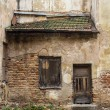 Wall and window of the old abandoned house in Vilnius, Lithuania — Stock Photo #64454327
