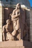 Sculpture on the basis of the Freedom Monument in Riga — Stock Photo
