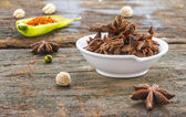The Star anise on wood texture for design or decorate project. — Stock Photo