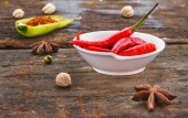 The chilli red on wood texture for decorate or design project. — Stock Photo