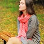 Sad woman portrait sitting on a bench. — Stock Photo #56717001