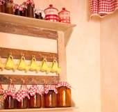 Cupboard with condiments, cups and cans. — Stok fotoğraf
