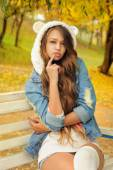 Pretty girl in a knitted bear hat. — Stock Photo