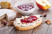 Bread served with camembert and cranberry. — Stock Photo