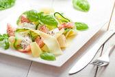 Fettuccine pasta with Salmon and zicchini — Stock Photo