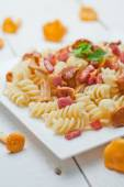 Fusilli pasta with mushrooms and bacon. — Stock Photo
