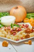 Fusilli pasta with mushrooms and bacon. — Stock Photo