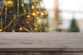 Christmas holiday or party background with empty wooden deck tab — Stock Photo