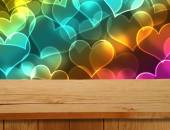 Valentines Design. Empty wooden deck table over hearts motif. Re — Stock Photo