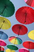 Collection of multi colored umbrellas hanging up. — Stock Photo