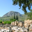 Постер, плакат: Corinthian columns sit among the ruins at Corinth Greece