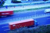 Freight cars traveling on the highway — Stock Photo