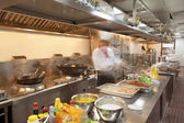 Chef cooking at commercial kitchen - hot job! — Stock Photo