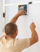Electrician man installing electric fuse at home — Stock Photo