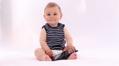 Hi Tech Baby. Boy playing with a laptop, tablet against white background — Vidéo