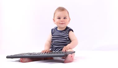 Hi Tech Baby. Boy playing with a laptop, tablet against white background — Video Stock