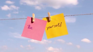 """Sentence """"Be Yourself"""" on colorful paper pinched on a rope. Positive thinking concept — Stock Video"""