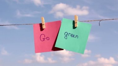 """Sentence """"Go Grren"""" on colorful paper pinched on a rope. Positive thinking concept — Stock Video"""