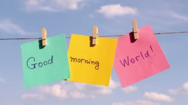 """Sentence """"Good Morning World"""" on colorful paper pinched on a rope. Positive thinking concept — Stock Video"""