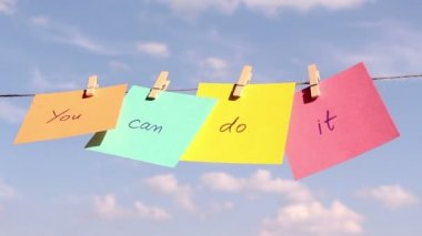 """Sentence """"You Can Do It"""" on colorful paper pinched on a rope. Positive thinking concept — Stock Video"""