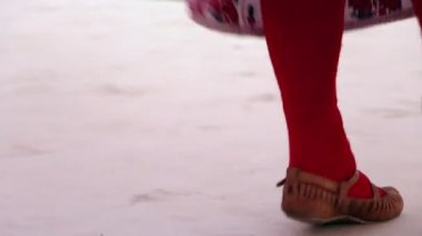 Bulgarian traditional dancers play in beautiful costumes, feet only — Stock Video