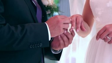 Groom and bride swapping wedding rings, closeup — Stock Video