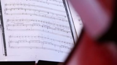 Musician playing on cello, notes before — Stock Video