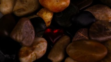 Red crystal heart among stones — Wideo stockowe