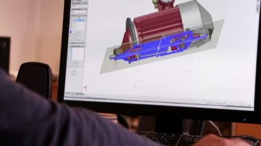 An engineer developing 3D model of electric motor in an electric motor plant. — Stock Video