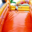 Young girl having fun on inflatable playground — Stock Video #61279231