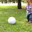 Cute little boy playing with soccer ball supported by his mother — Stock Video #61282323