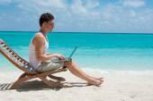 Man sitting with laptop — Foto de Stock