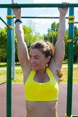 Athlete woman stretching on playground — Stock Photo